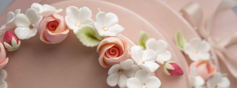 Birds-eye view rosebuds apple blossom wedding cake